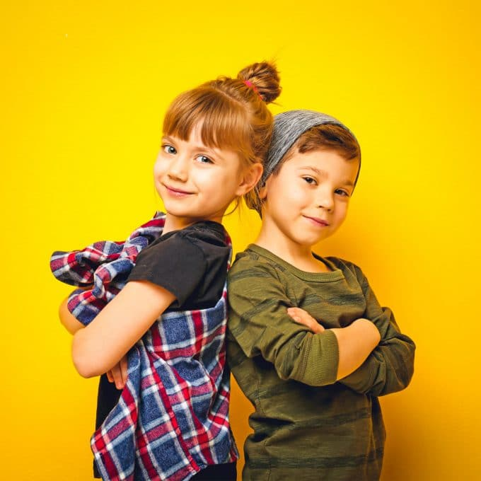 Kids studio photography against yellow backdrop