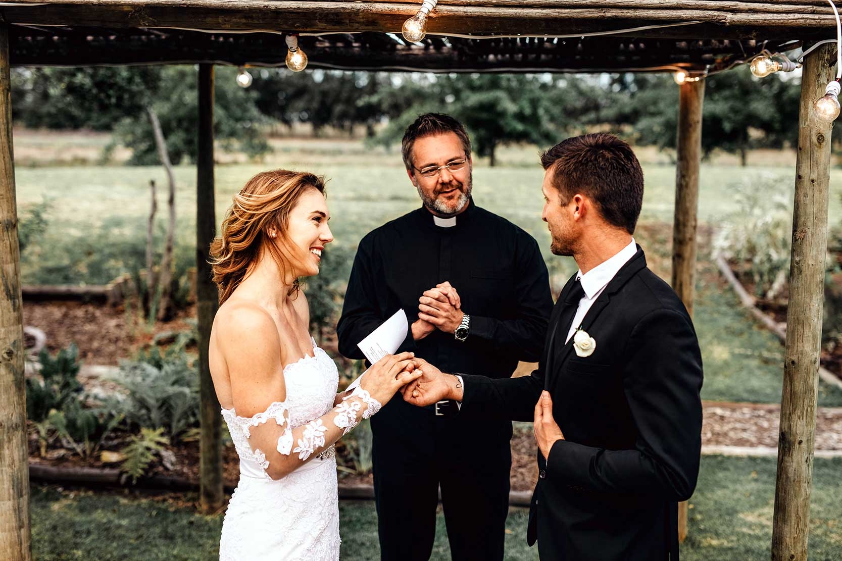 Young Couple reading wedding vows after preset has been applied