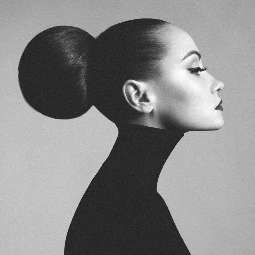 Elegant woman with black turtleneck. Art portrait, black and white photography