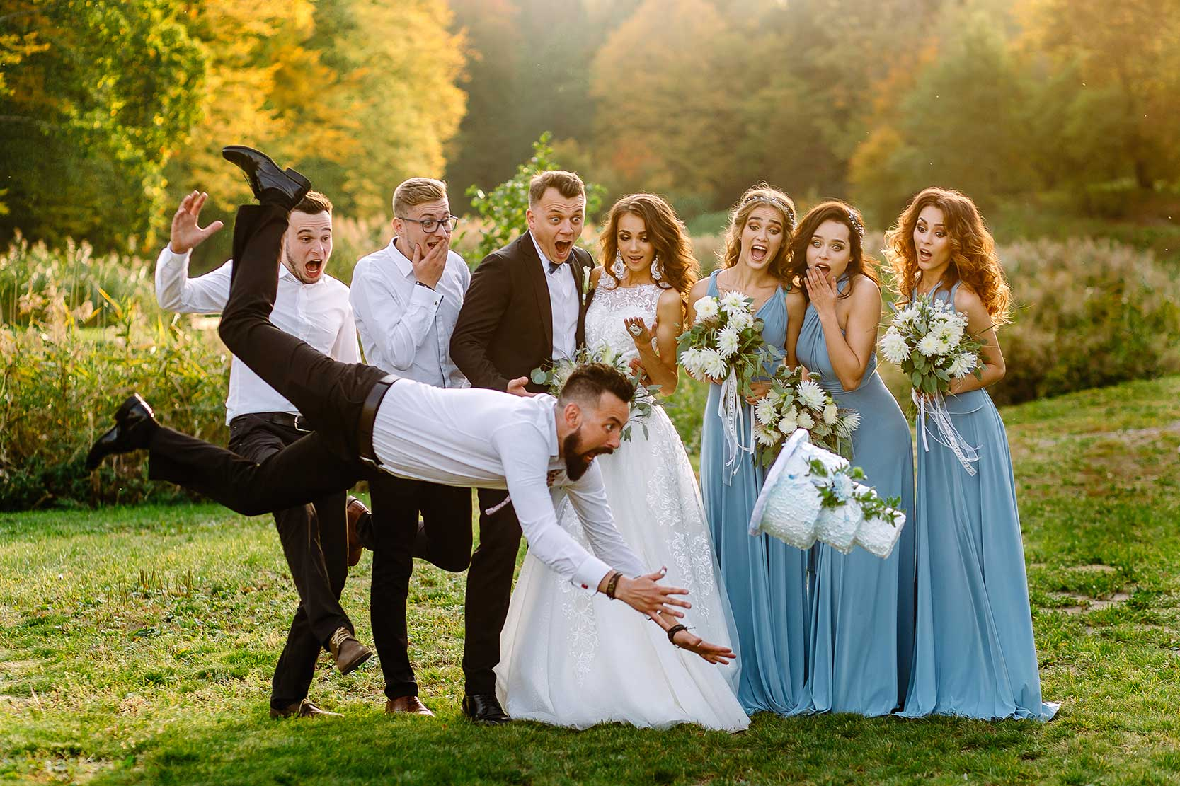 Funny photo of a man dropping a wedding cake