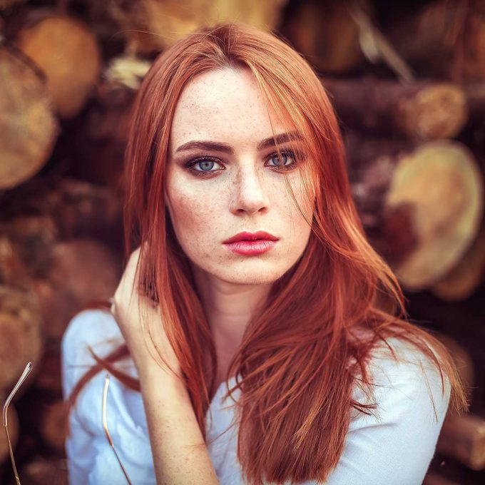 Portrait of a redhair woman with beautiful freckled skin
