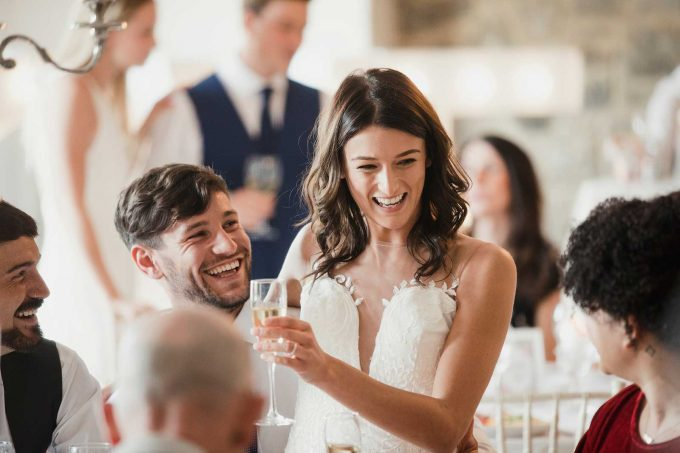 Happy Newlyweds socialising with the guests