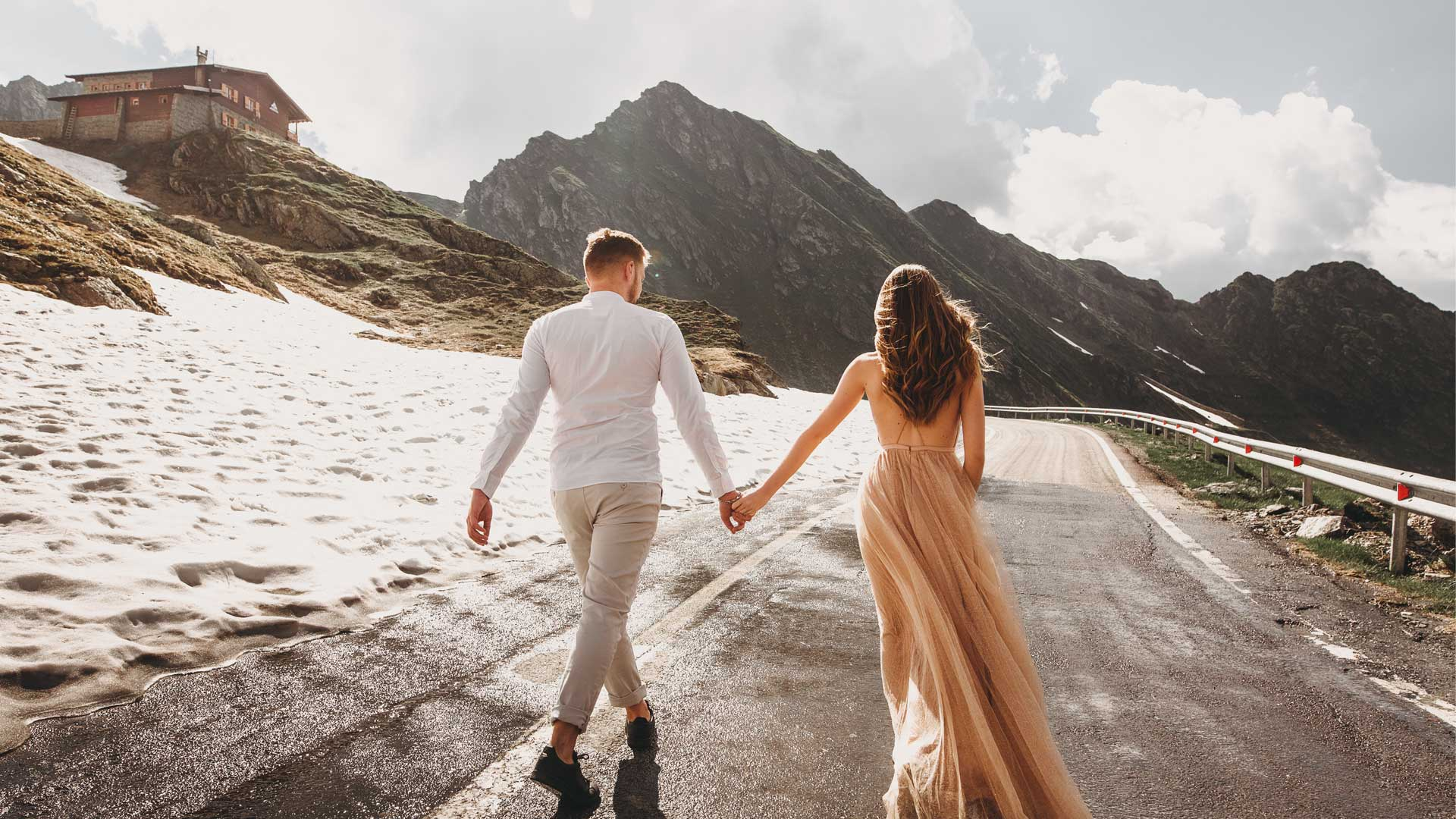 Romantic wedding couple with stunning view on the mountains. Edited using wedding Lightroom presets.