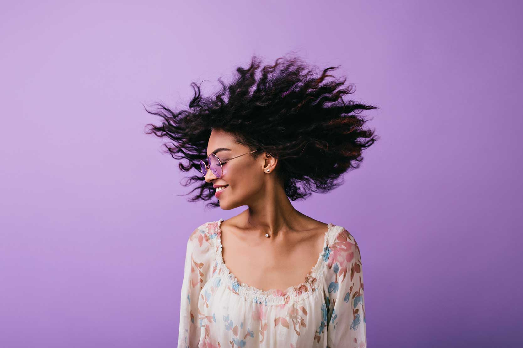 Portrait of a woman with hair blowing through the wind